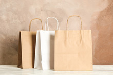 Paper Bags On White Table Agai...