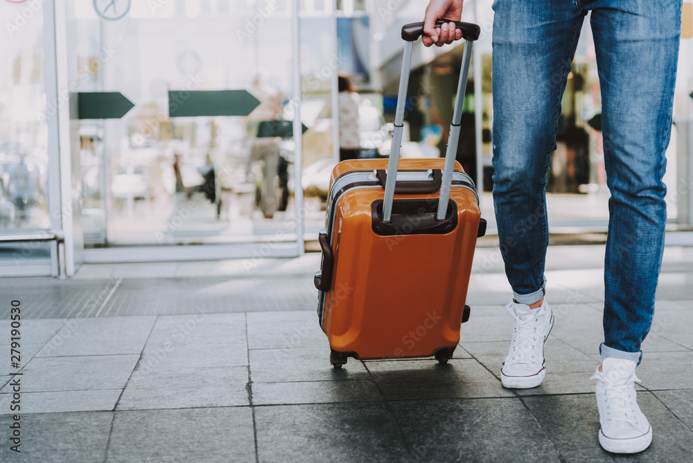 Fototapety, obrazy: Male is carrying luggage in hall before trip