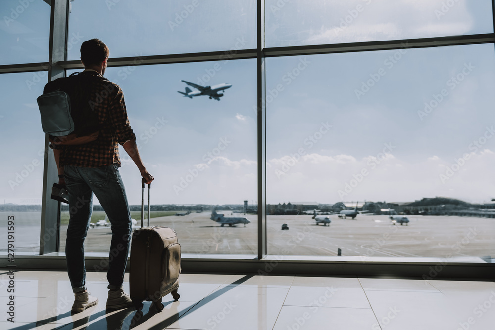 Fototapety, obrazy: Man is watching plane flying from airport