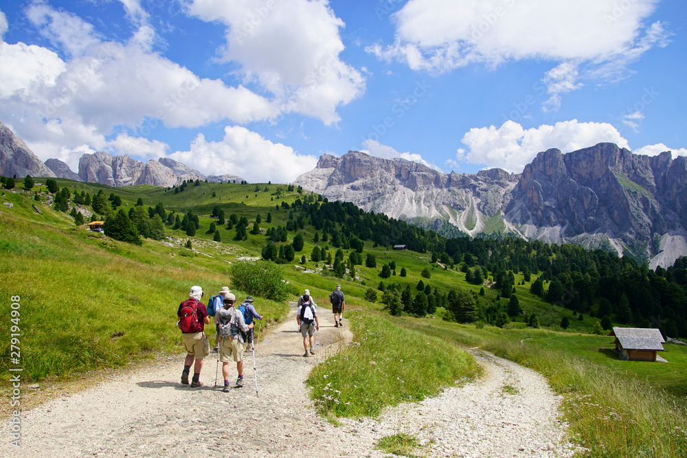 Fototapety, obrazy: Hikers on  mountain trail in the Dolomites
