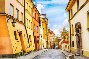 Fototapeta Warszawa Street with colorful houses in Old Town of Warsaw, capital of Poland.