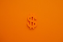 American Dollar Symbol On Orange Background Macro View