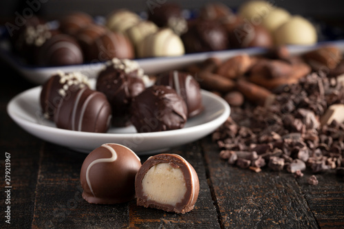 Fototapeta  Chocolate Truffles on a Rustic Wooden Table