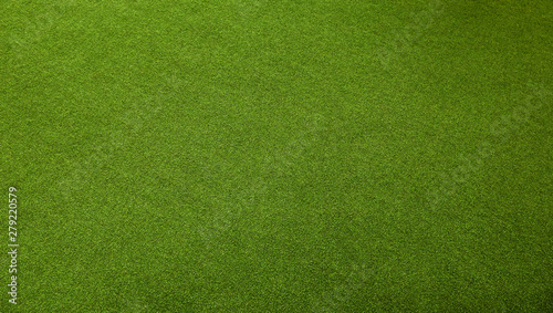 Foto auf Leinwand Gras An artificial green grass background, perspective view, wide shot