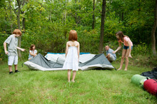 Family Folding Up Tent In Forest