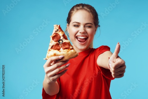 young man eating pizza Poster Mural XXL