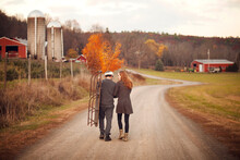 Young Couple Walking On Rural Road