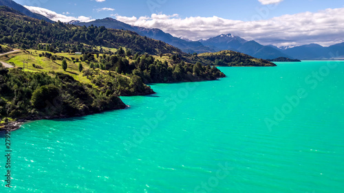 Wall Murals Green coral Blue Lake in The Mountains