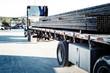 Girders transported on semi-trailer truck