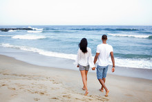Young Couple Walking On Beach ...