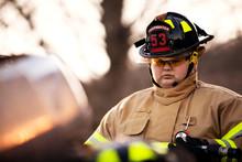 Firefighter On Car Crash Site