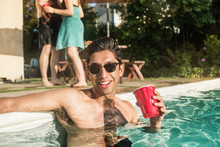 Young Man With Red Cup In Swim...