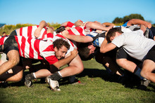 Young Men Playing Rugby In Field