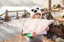Girl (8-9) Holding Map