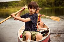 Boy Rowing Boat In Lake