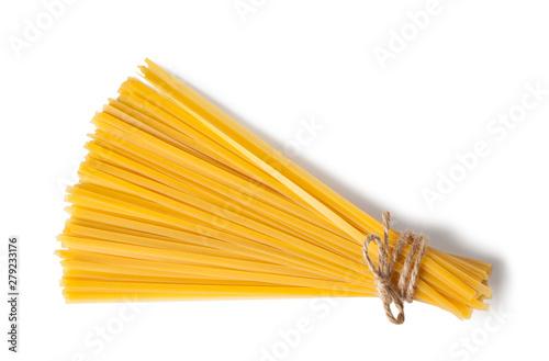 Tela Raw pasta tagliatelle, spaghetti, isolated on white background