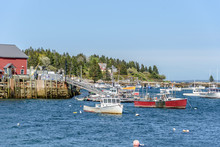 New England Harbor In Maine With A Lobster Boat Anchored In A Bay