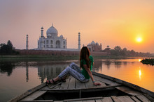Woman Watching Sunset Over Taj Mahal From A Boat, Agra, India