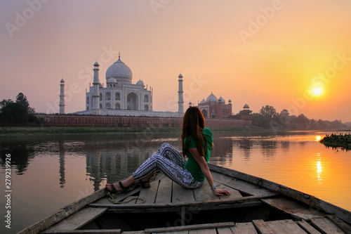 Woman watching sunset over Taj Mahal from a boat, Agra, India Wallpaper Mural