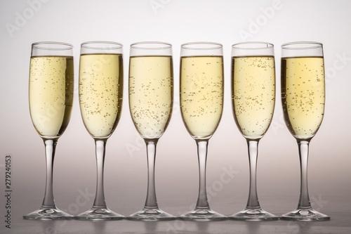 Stampa su Tela Six Champagne Glasses on Grey Background