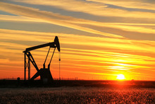 Pump Jack In The Oil Field At Sunset