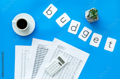 Fototapeta Accounting, calculator, coffee and word budget on blue background top view obraz