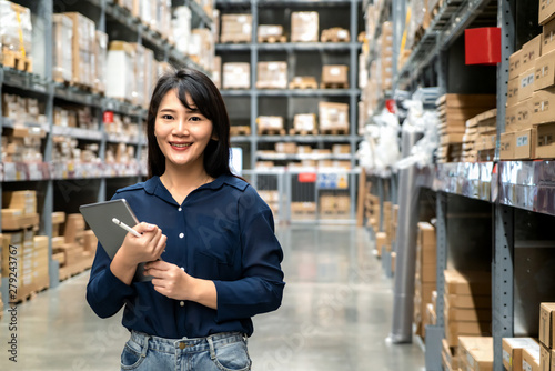 Young asian woman auditor or trainee staff work looking up and checks the number of items store by digital tablet Canvas Print