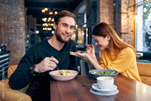 Foto op Canvas Kruidenierswinkel young couple having dinner in restaurant