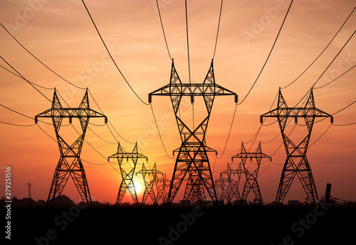Leinwand Poster electricity pylons at sunset