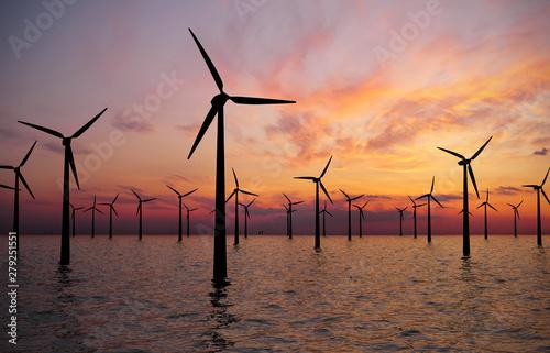 Obraz na plátně  wind turbines at sunset