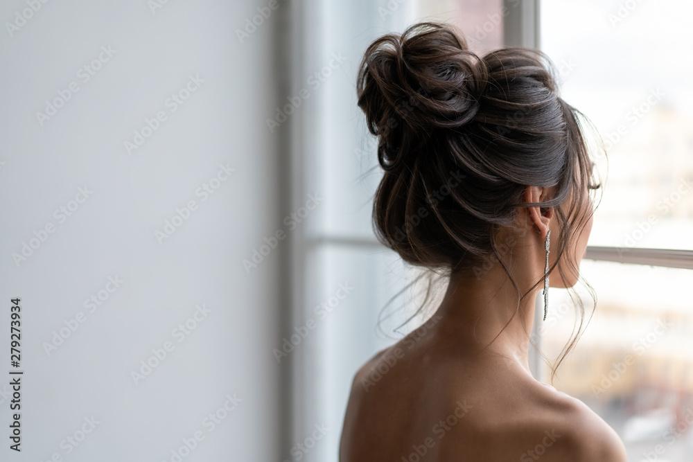 Fototapeta Hair do with an elegant bridal hair accessorie. wedding hairstyle for girls
