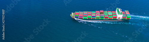 Fotomural  Container ship carrying container for import and export, business logistic and transportation by ship in open sea, Aerial view container ship with copy space