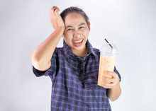 Asian Young Woman Touching Head With Hand Because She Brain Freeze From Drinking Cold Water. Health Care Concept.