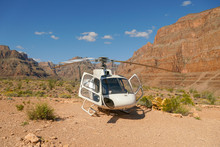 Helicopter Parked Near The Bottom Of The Grand Canyon During Summer Hot Day. Famous Tourist Attraction