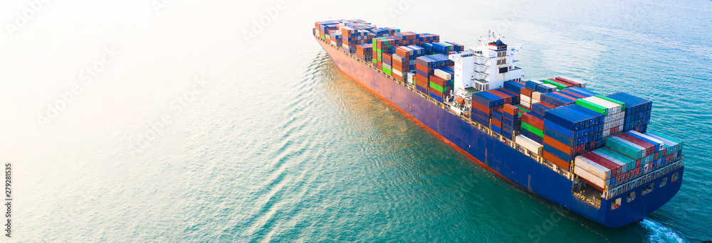 Fototapety, obrazy: Aerial side view container ship carrying container in import export business logistic and transportation of international by container ship in the open sea, with copy space.