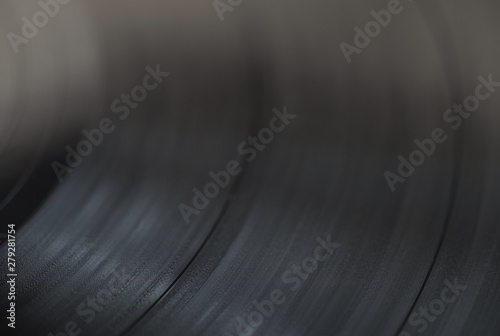 A close look at the music track on a vinyl record, selective focus, macro. - 279281754