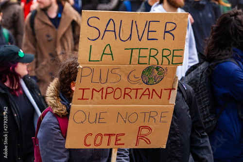 Fototapety, obrazy: French sign at ecological rally. A closeup view of a cardboard French poster, saying save the earth more important than our r rating, held by an environmental campaigner during a street protest