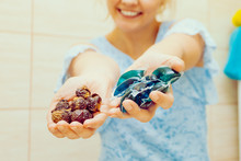 Woman Show Soap Nuts And Gel Pods Detergent.