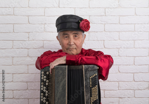 Russian man playing the accordion - Buy this stock photo and explore