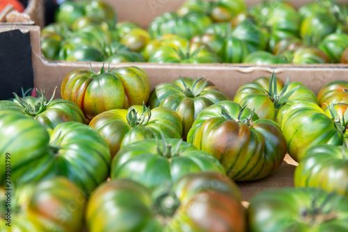 Cadres-photo bureau Zebra Fresh raw green tomatoes sold on outdoor market. Farm seasonal spanish fruits and vegetables