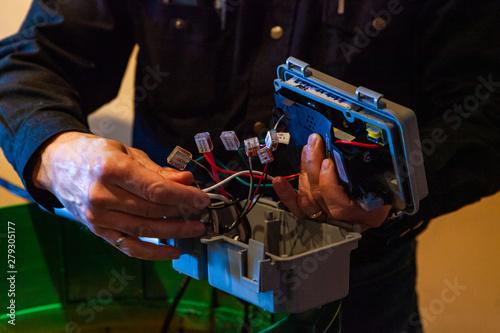 Valokuvatapetti Lady is plugging septic distribution box