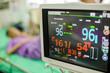 Modern vital signs monitor display at ICU in hospital.