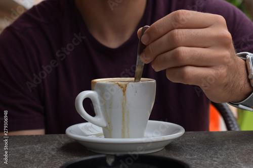 Removiendo Un Cafe En La Terraza De Un Bar Buy This Stock