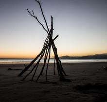 Tee Pee On The Beach At Sunrise