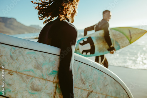 Fototapeta Surfers going for surfing in the sea obraz