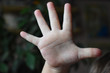 child hand is showing five fingers