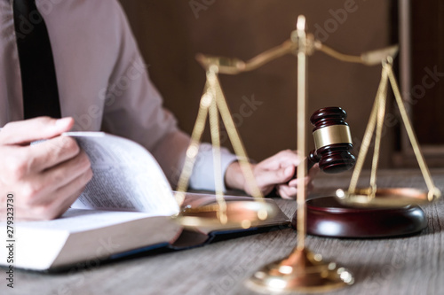 Judge gavel with scales of justice, male lawyers working having at law firm in office Canvas-taulu