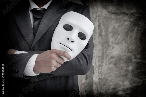 Canvastavla  Businessman holding white mask in his hand dishonest cheating agreement