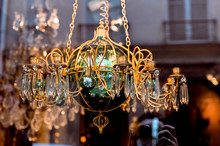 Antique Shop In Paris. Chandeliers And Crystal. The Decor And Interior In The Old Style.