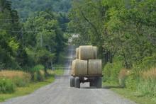 Tractor Pulls Wagon Of Round B...